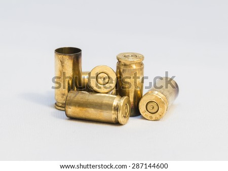 group of bullet shells over white background - stock photo