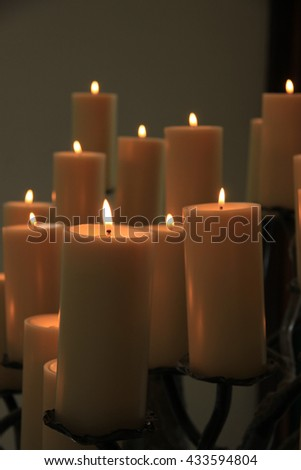 Group of burning candles at a funeral service