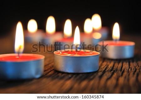 group of burning candles on dark background - stock photo