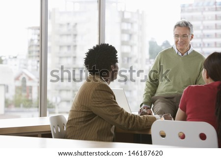 Group of business colleagues at office meeting - stock photo