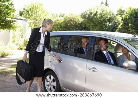 Group Of Business Colleagues Car Pooling Journey Into Work - stock photo