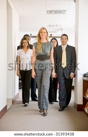 Group of business colleagues walking in the office
