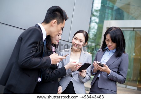 Group of business discuss on cellphone