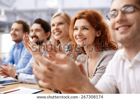 Group of business partners applauding at conference - stock photo