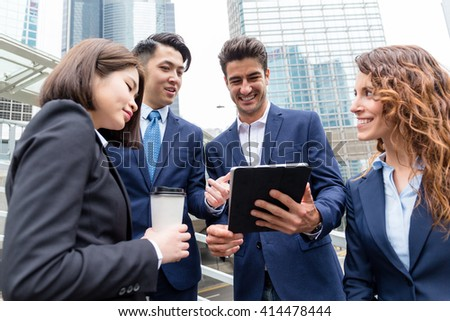 Group of business partners discussing ideas and planning work - stock photo