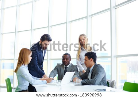 Group of business partners discussing new project - stock photo