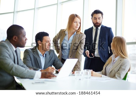 Group of business partners discussing plan - stock photo