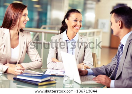 Group of business partners discussing their plans - stock photo