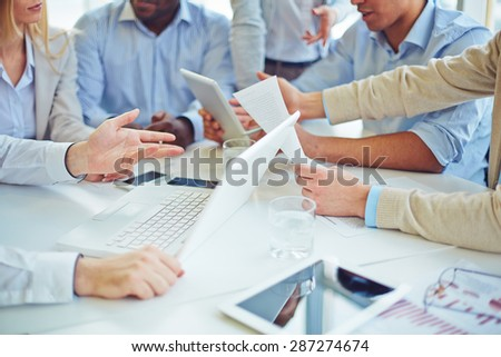 Group of business partners having discussion - stock photo