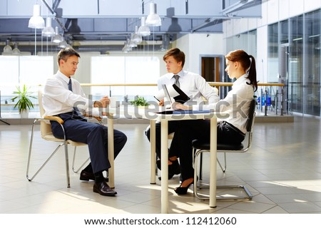 Group of business partners interacting at meeting - stock photo