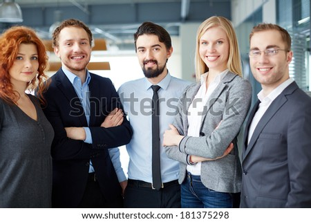 Group of business partners looking at camera with smiles - stock photo