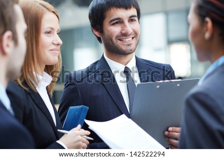 Group of business partners negotiating, focus on smart man