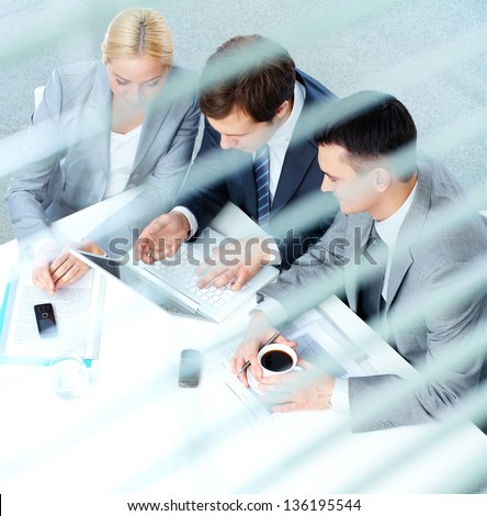 Group of business partners working at meeting in office