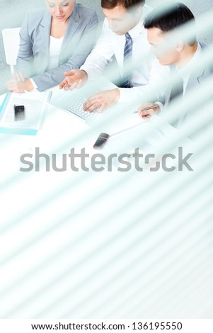 Group of business partners working at meeting in office - stock photo