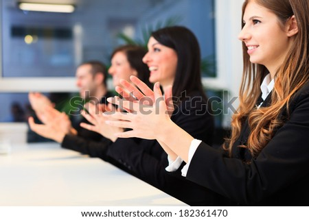 Group of business people applauding - stock photo