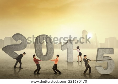 Group of business people arrange number 2015 outdoors in the morning - stock photo