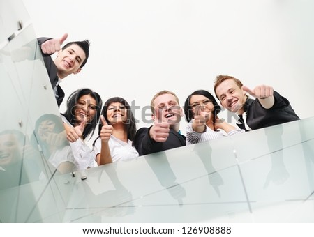 Group of business people at office with thumbs up - stock photo