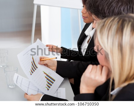 Group of business people at presentation applauding to the lecturer - stock photo