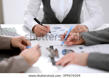 Group of business people at the meeting discussing financial results