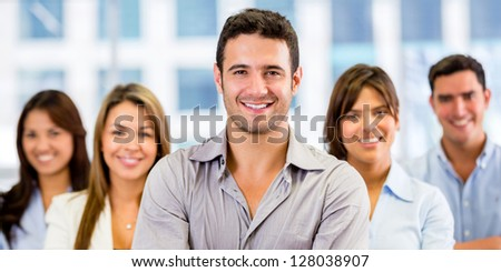 Group of business people at the office looking happy
