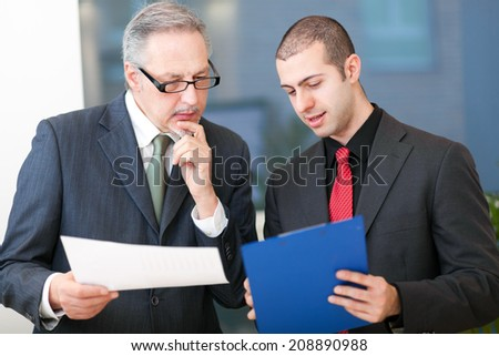 Group of business people at work in their office - stock photo