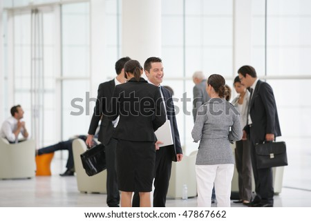 Group of business people attending a meeting