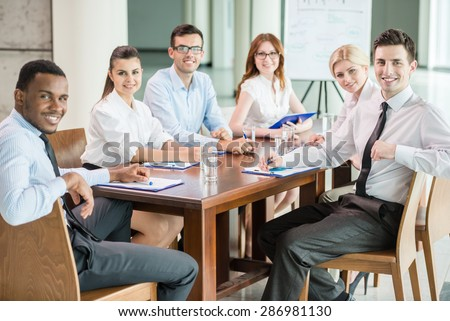 Group of business people brainstorming together in the meeting room. - stock photo