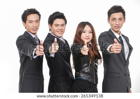 Group of business people. Business team holding their thumbs up - stock photo