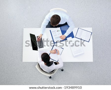 Group of business people busy discussing financial matter  - stock photo