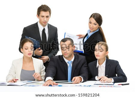 Group of business people debating while sitting at the table, isolated on white. Concept of teamwork and cooperation - stock photo