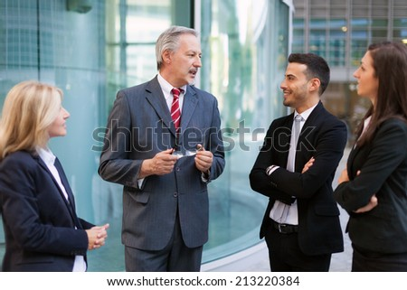 Group of business people discussing - stock photo