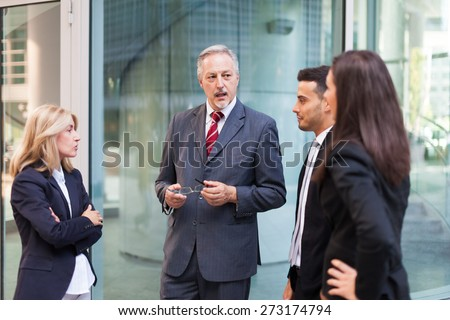 Group of business people discussing about something - stock photo