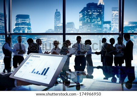 Group of business people discussing at city view reflected onto table with document. - stock photo