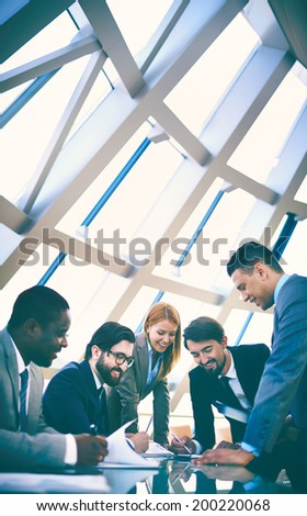Group of business people discussing data or planning work at meeting - stock photo