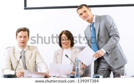 group of business people discussing documents, teamwork