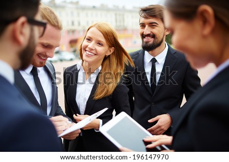 Group of business people discussing ideas at meeting outside - stock photo