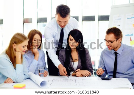 Group of business people discussing new architect project - stock photo