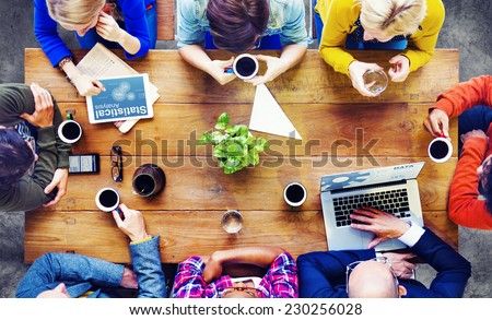 Group of Business People Discussing on a Cafe - stock photo