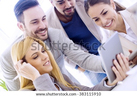 Group of business people discussing.They are using a digital tablet at meeting. - stock photo