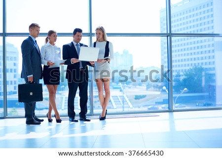 Group of  business people doing presentation with laptop during meeting - stock photo