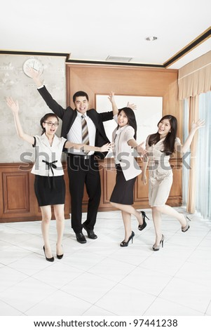 Group of business people expressing their excitement in the office - stock photo