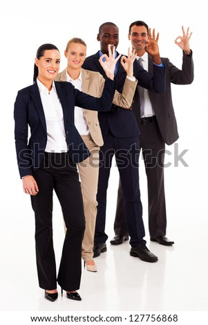 group of business people giving ok hand sign - stock photo