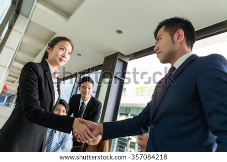 Group of business people hand shaking for making a deal - stock photo