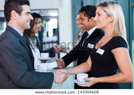 group of business people handshaking during seminar - stock photo