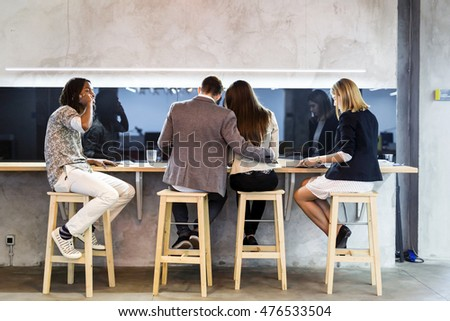 Group of business people having a break in the cafeteria