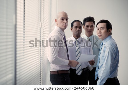 Group of business people having briefing in the office - stock photo