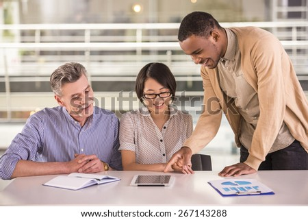 Group of business people having meeting with tablet  in office. - stock photo