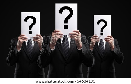 group of business people holding a question mark - stock photo