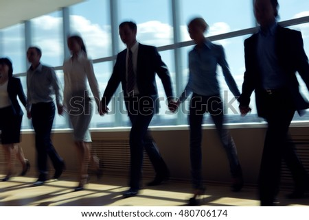 Group of business people holding hands and walking
