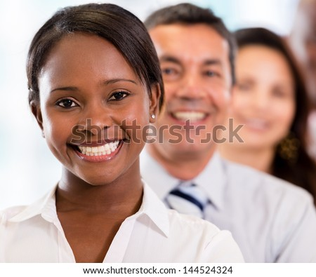 Group of business people in a row at the office - stock photo